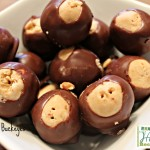 Peanut butter balls dipped in chocolate in white bowl
