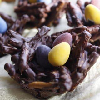 chocolate birds nest recipe with mini tiny candy eggs on yellow linen napkin