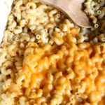 vertical macaroni and cheese in white baking dish