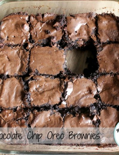chocolate chip oreo brownies in a 8x8 baking dish with a piece missing