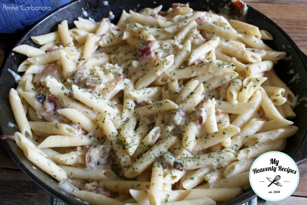 penne carbonara with bacon in skillet