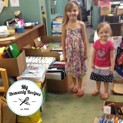 Girls donating school supplies to interparish ministry
