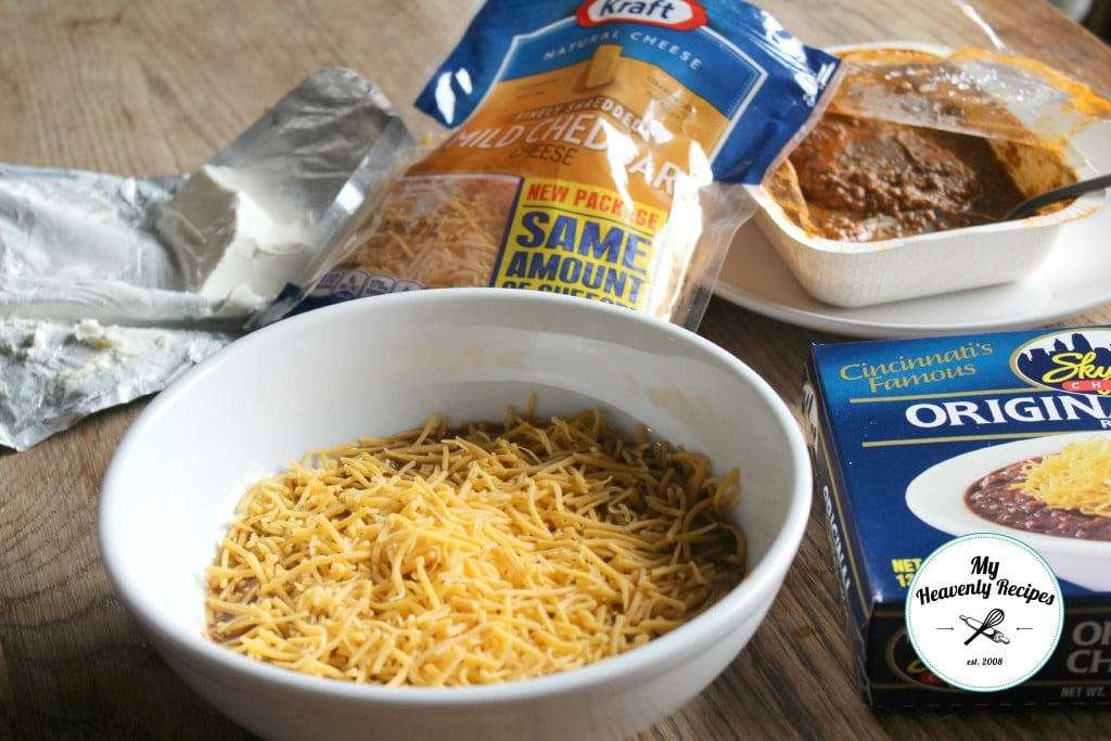 Skyline Dip with cream cheese, bag of shredded cheese, skyline chili and bowl with all of the ingredients