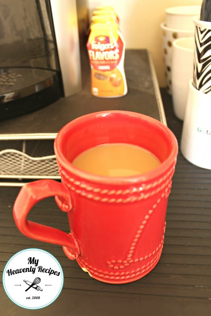 a red coffee mug filled with caramel flavored coffee