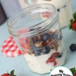 fruit parfait with yogurt, homemade granola and fresh berries, served in a mason jar