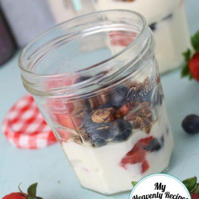 fruit parfait with yogurt, homemade granola and fresh berries, served in a mason jar