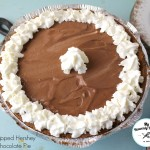 chocolate pudding pie with homemade whipped cream ran along the outside and a dab in the center