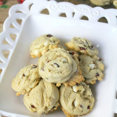 cranberry cookies with white chocolate chips on a white serving platter