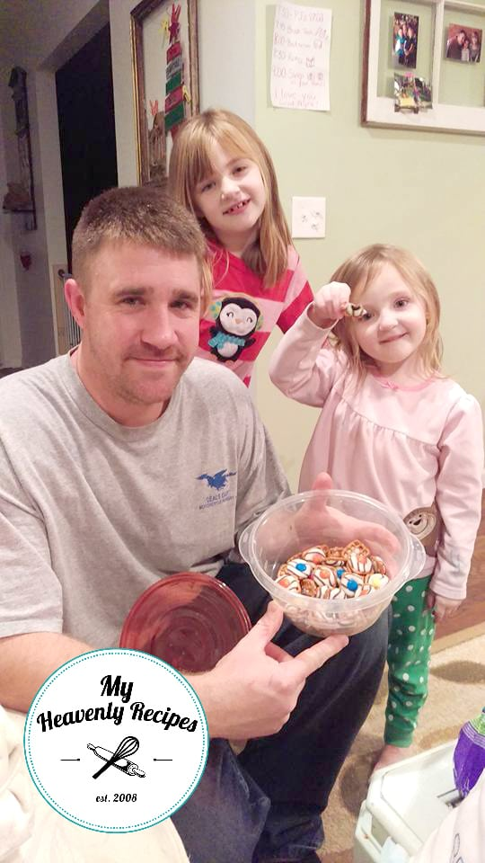 father and 2 daughters showing off their no bake treats - Hershey Kiss Pretzels