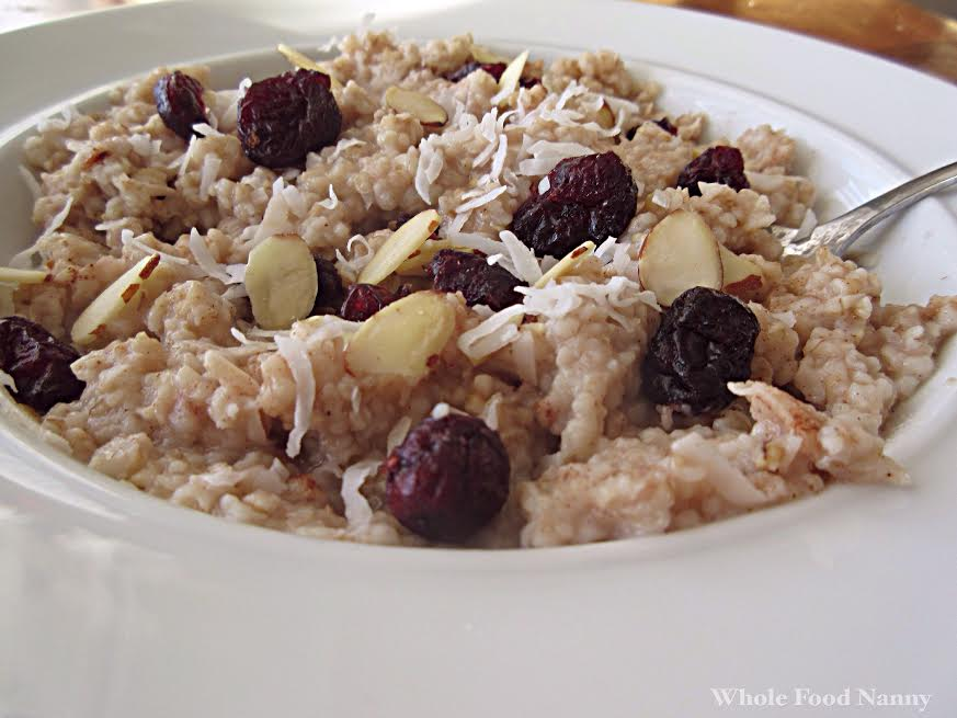 bowl of steel cut oatmeal with shredded coconut, almonds, and dried fruit