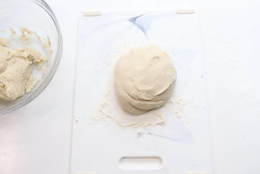 pizza dough on a board