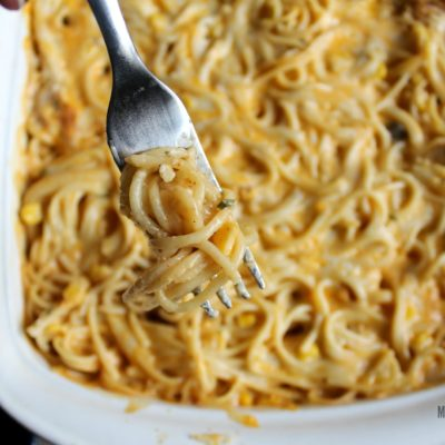 cheesy chicken spaghetti casserole on a fork