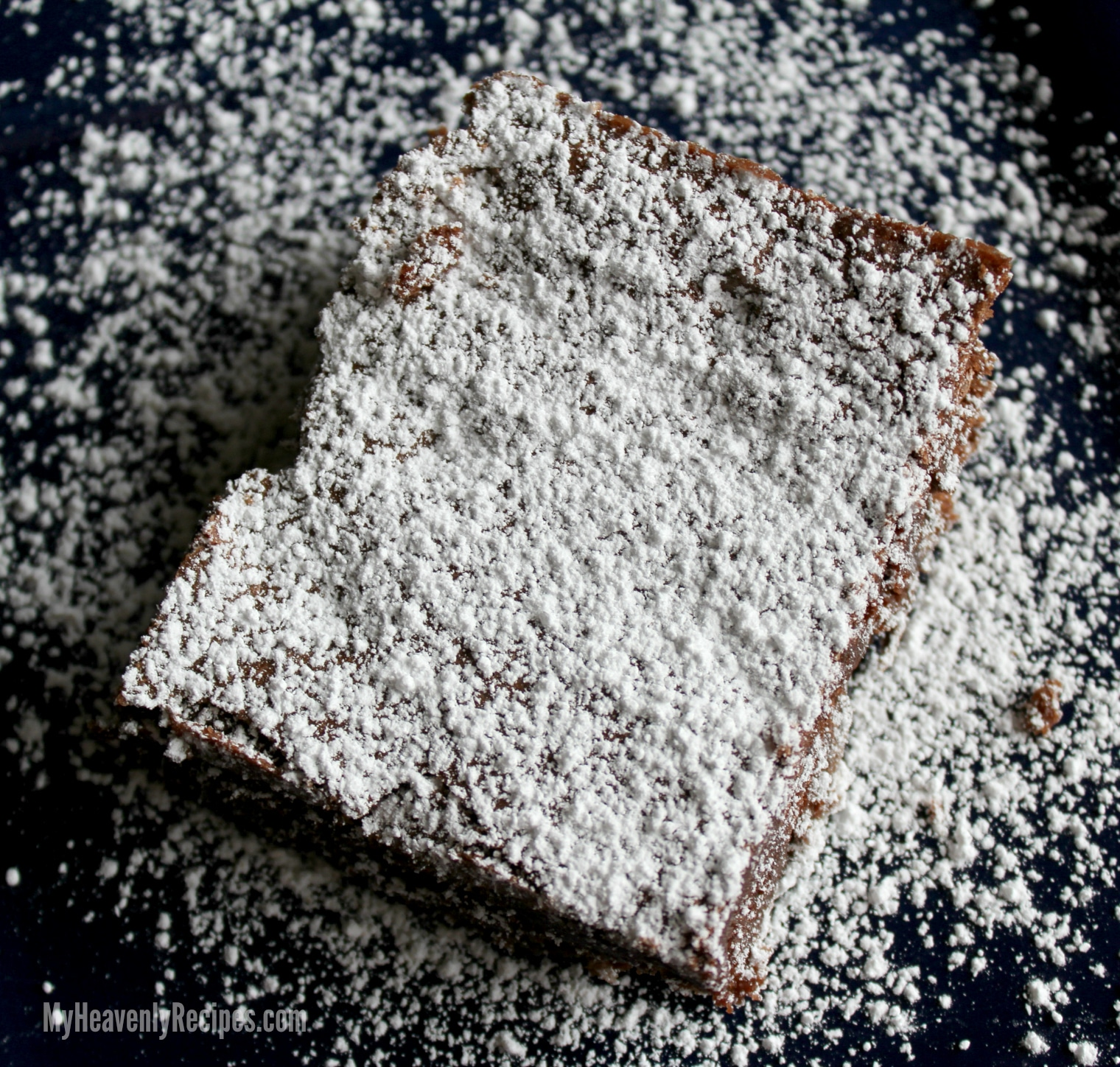 homemade brownie dusted with powdered sugar