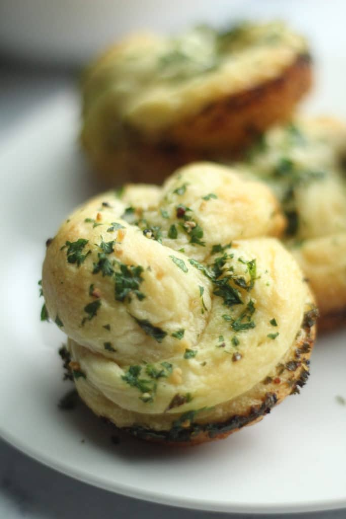 close up of garlic knots on plate