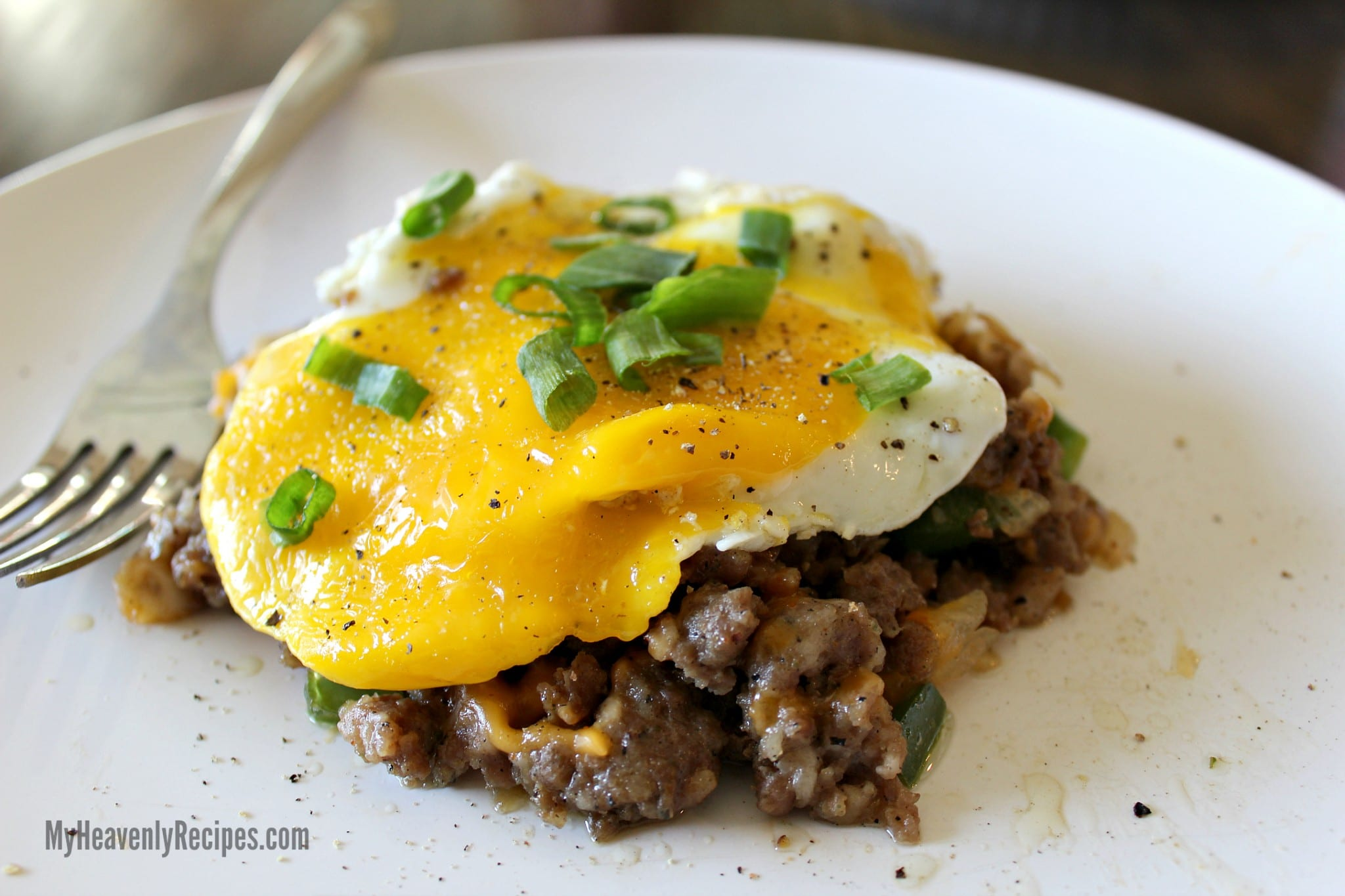 fried egg and sausage hash garnished with sliced green onions