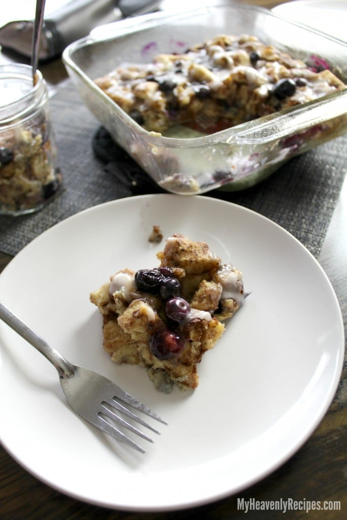 Scoop of Cinnamon Roll Blueberry French Toast Breakfast Bake
