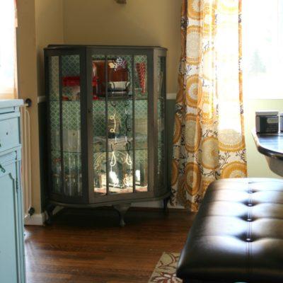 photo shows a curio cabinet makeover