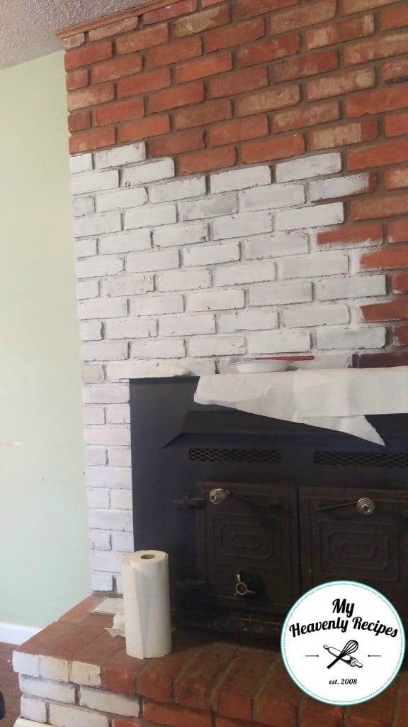painting a brick fireplace with white chalk paint