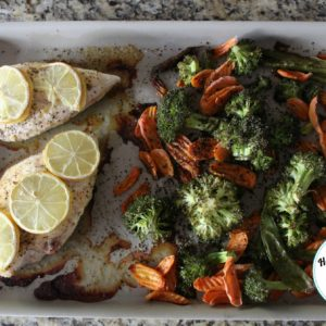 lemon chicken and vegetables on a large bar pan