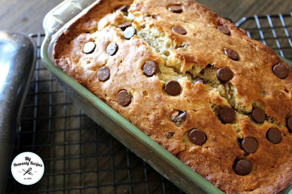 oven mitt with banana bread in dish on cooling rack