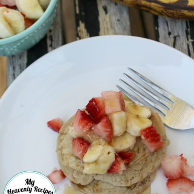 Top these Healthy Banana Pancakes with strawberries and bananas for a over the top breakfast recipe.