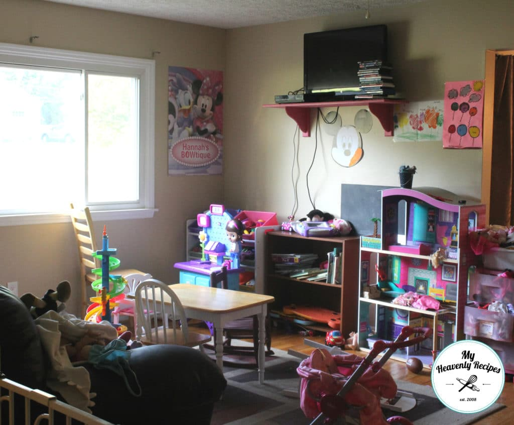 a messy playroom full of toys, books and a unusable space