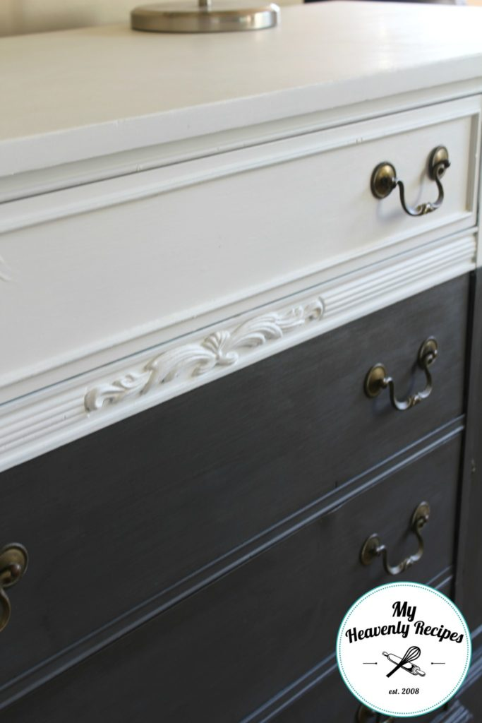 close up image of the detailed wood trim on a farmhouse buffet