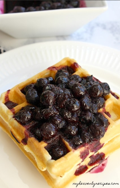 stack of waffles topped with blueberry compote