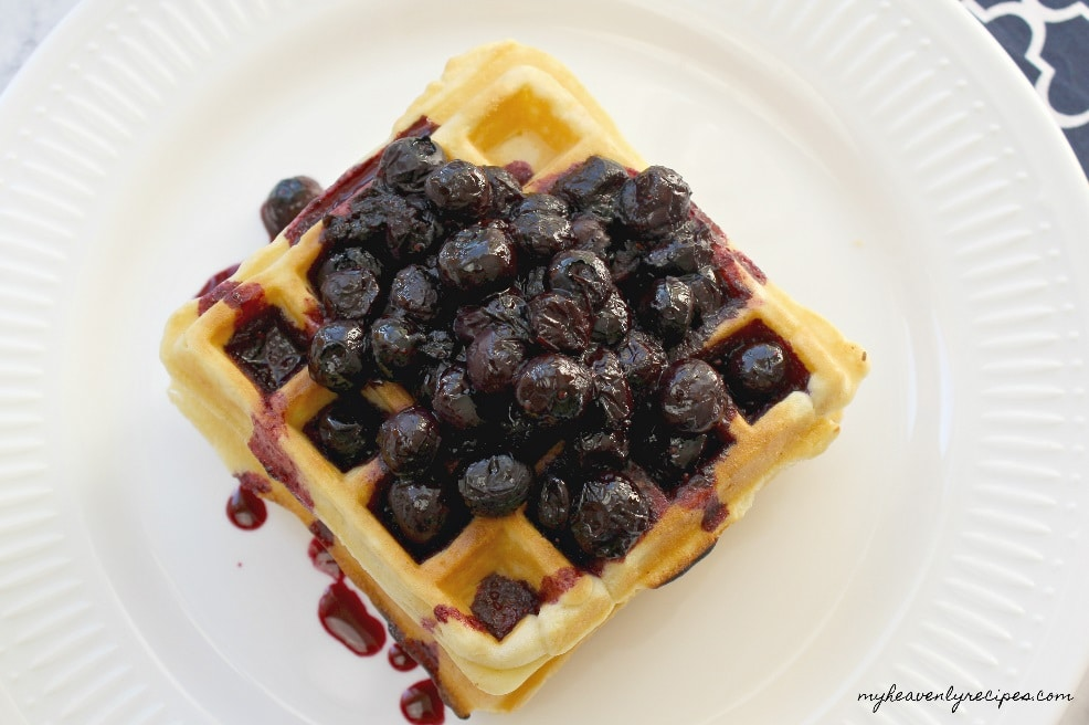 homemade blueberry compote on top of waffles