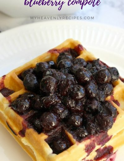 Waffles on white plate topped with blueberry compote