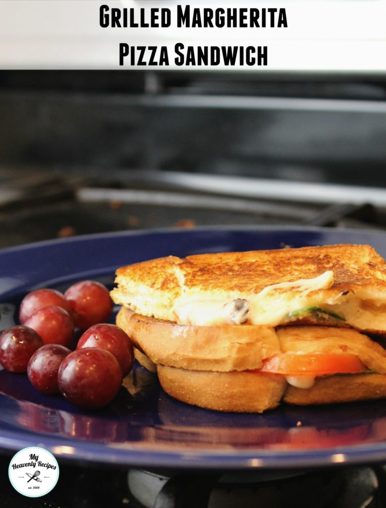 grilled margherita pizza sandwich on a plate with purple grapes