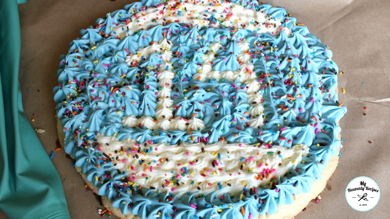 Ultimate Sugar Cookie Cake decorated with blue and white whipped buttercream frosting