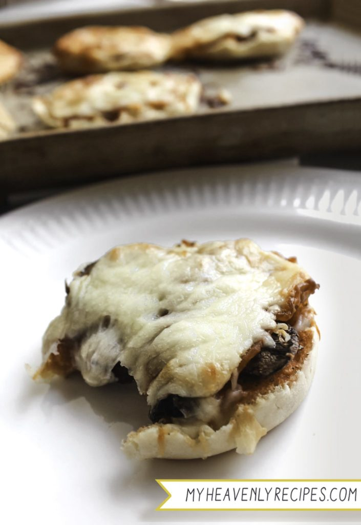 vertical english muffin pizza cooked with mushroom and cheese