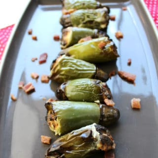 Bacon Stuffed Jalapeno Peppers have a little bit of heat, crunch from the bacon and the cream cheese cools it all down. Try this appetizer recipe at your next party!