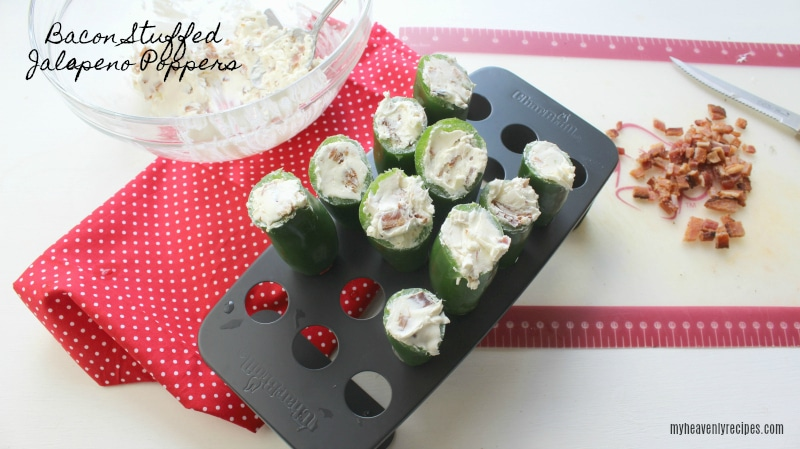 bacon stuffed jalapeno poppers on a serving tray