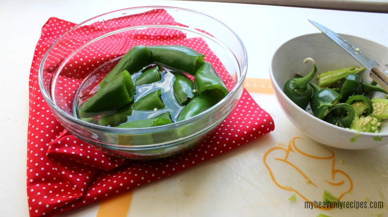 soaking jalapeno peppers in bowl of cold water