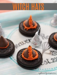 oreo cookie with hershey kiss and orange icing to create witch hats for a halloween snack