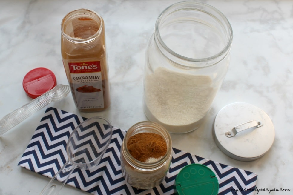 There's nothing more than a mason jar, lid, measuring cup and tablespoon needed to make this Cinnamon Sugar Mixture.