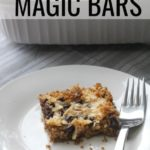 Magic Bars plated on white plate and baking dish in background