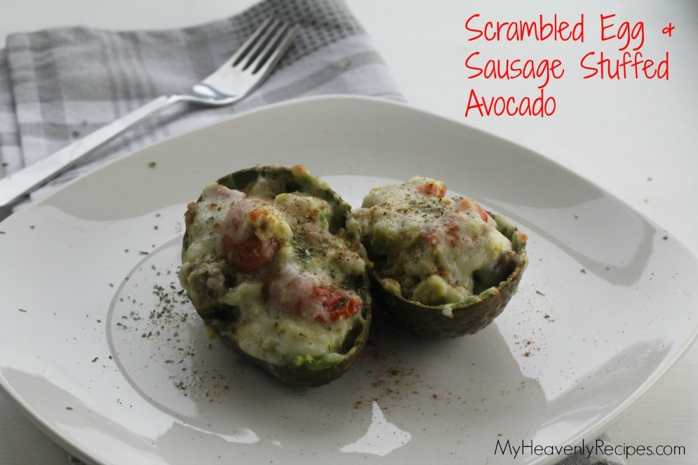 stuffed avocado breakfast - avocado halves filled with, cheese, sausage and scrambled eggs