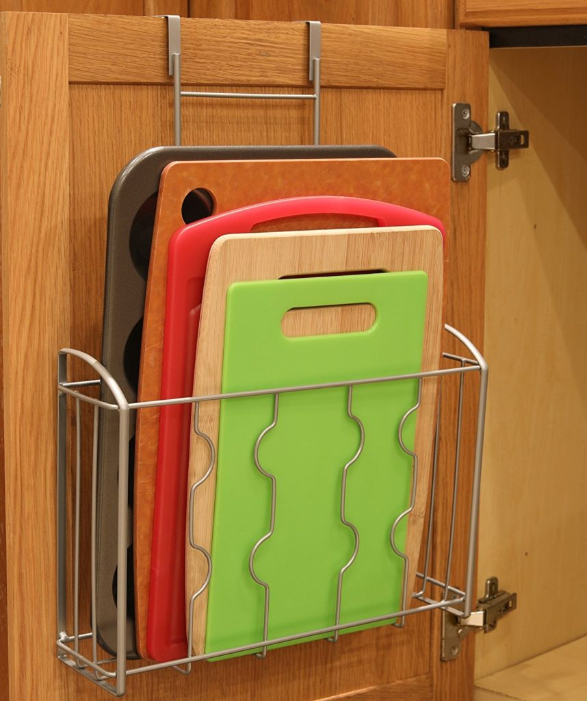 cutting boards being stored in a over the cabinet door organizer