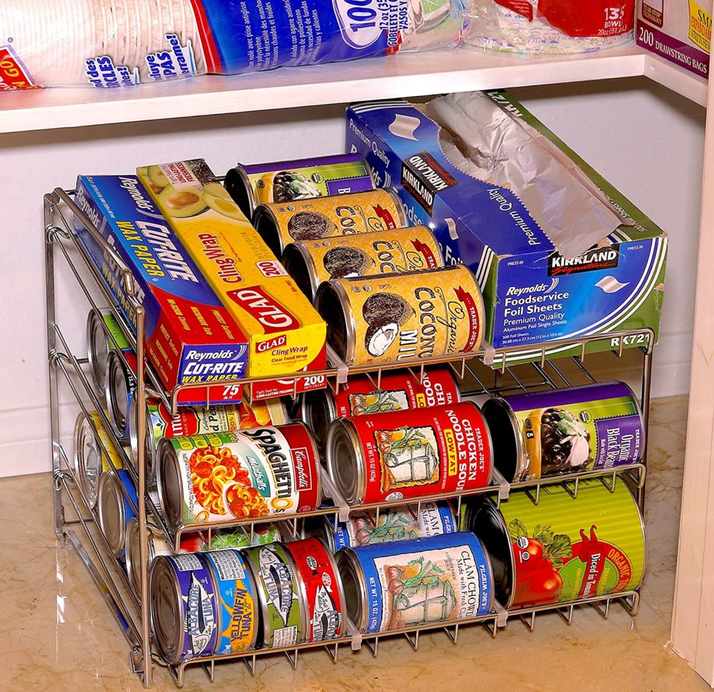 stackable can rack organizer on floor of pantry