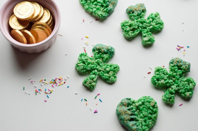 st. patrick's day dessert on a grey table with sprinkles and a bowl of gold coins