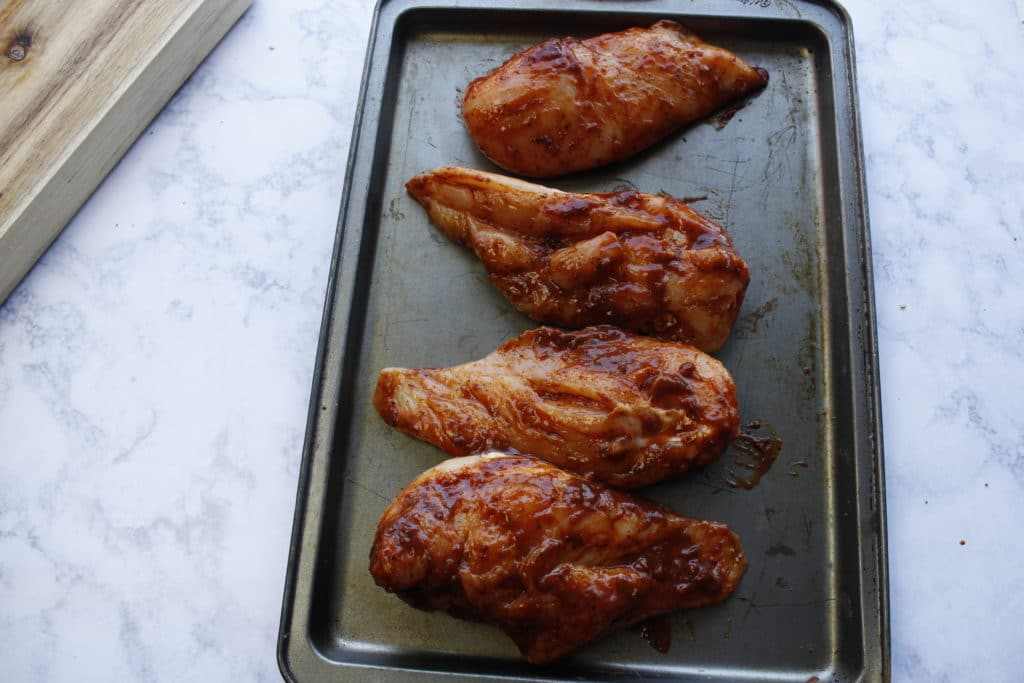 Alice springs chicken recipe on a baking sheet