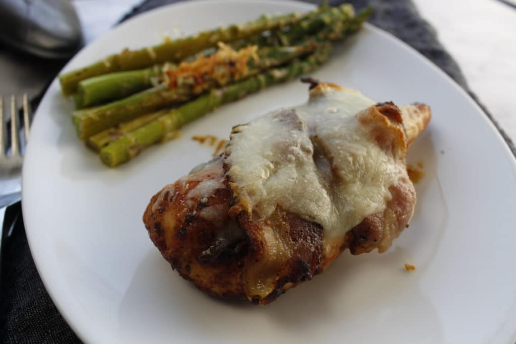chicken on a plate with asparagus