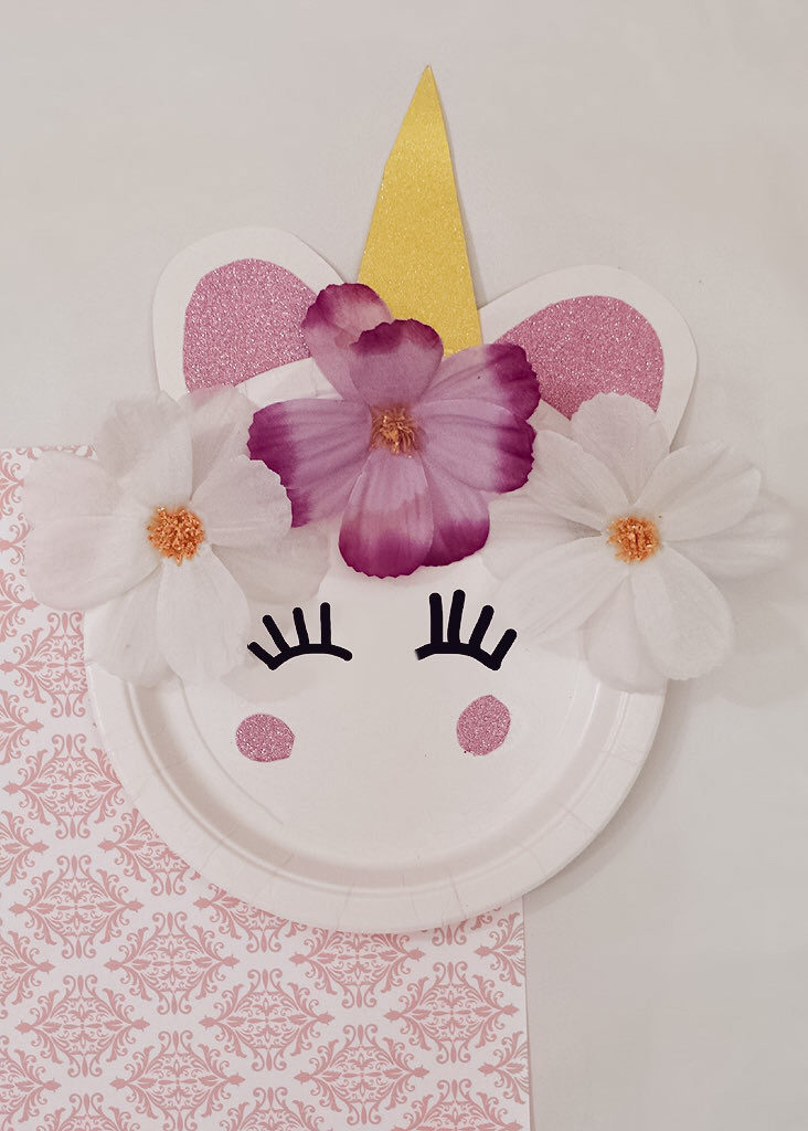 unicorn craft plate fully complete on top of pink and white towel