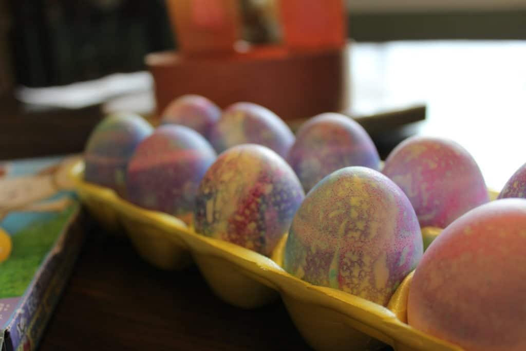 shaving cream decorated Easter eggs in egg carton