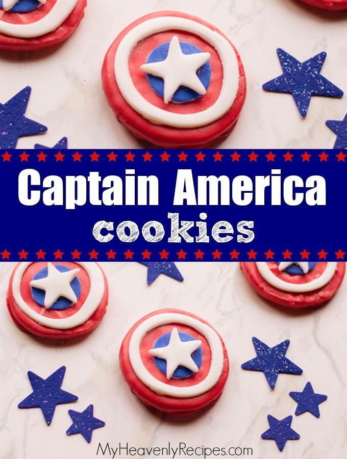 several captain america cookies on a countertop among blue stars