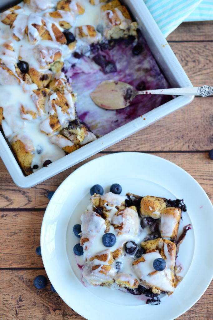 overhead shot of blueberry cinnamon roll french toast on plate and in baking dish