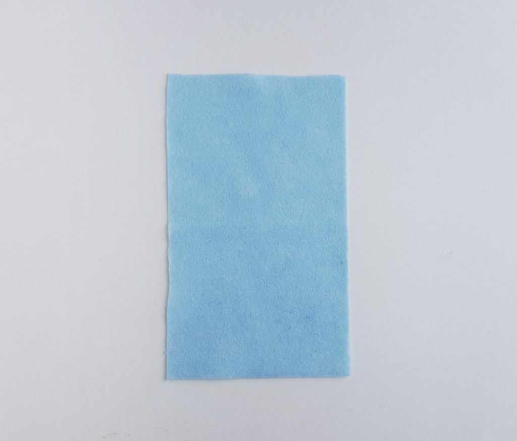 blue fabric rectangle to be used in a unicorn pencil case